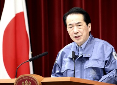 A visually shaken Naoto Kan speaks at a government press conference earlier today.
