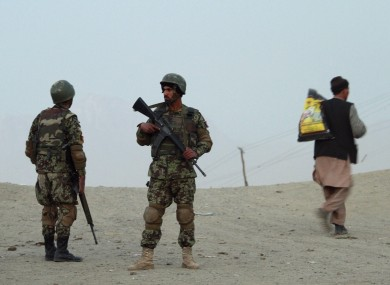 Officers of the Afghan army stand on patrol. A German magazine has published photos of US soldiers apparently posing with the corpses of dead Afghan civilians.