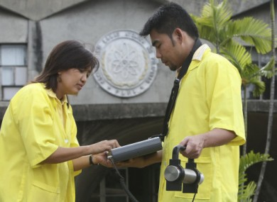 Filipino scientists at the Philippine Nuclear Research Institute monitor the gamma radiation levels in the atmosphere using a SAM portable Gamma Spectrometer