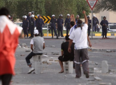 Anti-government protesters gesture towards riot police in Bahrain last month.
