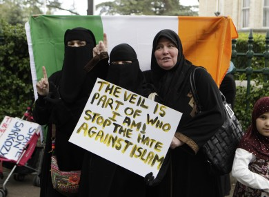 Members of the Irish Arab and Semite Solidarity movement protest outside the French Embassy in Dublin against the recent French ban on religious clothing.