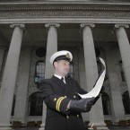Naval Lieutenant Paul O'Brien who reads the proclamation.