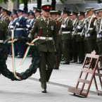 A wreath is carried by members of the Irish Defence Forces.