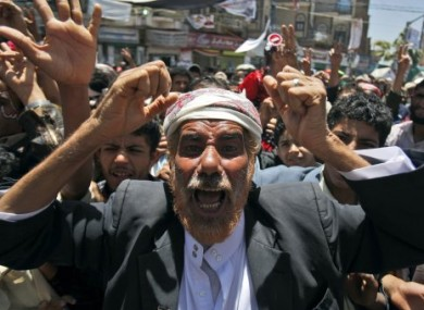 An anti-government protester during a demonstration demanding Saleh's resignation in Sanaa, Yemen, today.