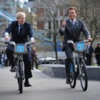 London Mayor Boris Johnson takes former Governor of California Arnold Schwarzenegger for a ride in London. Words fail us. Pic: PA Wire/Stefan Rousseau.
