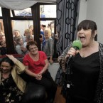 Mary Byrne gives a private concert to a competition winner in her front room. Image: Sasko Lazarov/Photocall Ireland.