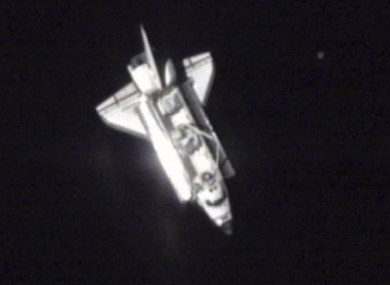 A photo made from NASA video shows Endeavour over the western Pacific as it approached the ISS today.