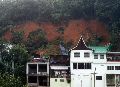 An orphanage, partially seen at left in background, is half-buried by a landslide in Hulu Langat in central Selangor state, outside Kuala Lumpur, Malaysia on Saturday.
