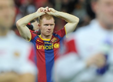Paul Scholes stands dejected following their defeat to Barcelona during the UEFA Champions League Final  on Saturday night.