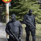 Members of Serbia's anti-terrorist unit pepare to search Mladic's home in February 2010. Armed officers blocked the street in the residential Belgrade area. <span class=