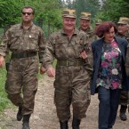 June 1996: Mladic (centre) and his wife Bisiljka walk with bodyguards through woods near the village of Han Pijesak, 60km east of Sarajevo. Bosiljka Mladic was brought in for questioning in June 2010 over weapon's found during a search of the fugitive's house<span class=
