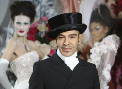 25 January 2010: Galliano poses at the end of the Dior Haute Couture Spring/Summer 2010 collection in Paris.