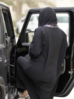 A woman gets into a car in Riyadh, Saudi Arabia