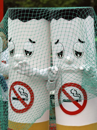 Two activists dressed as cigarettes are caught in a net during a non-smoking campaign in Seoul, South Korea.