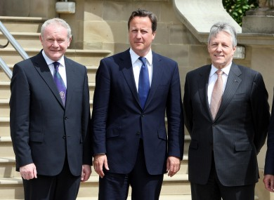 Prime minister David Cameron meets Martin McGuiness (left) and Peter Robinson (right) at Stormont this morning.