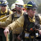 Firefighter Craig Ogden of the Red Rock Interagency Crew looks on before going to fight the fire on 19 June, 2011. (AP Photo/ The Arizona Republic, David Wallace)