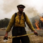 A firefighter protects a backburn to fight the Wallow Fire in Nutrioso, Arizona. (AP Photo/Marcio Jose Sanchez)