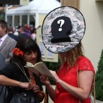 A reporter for The Sun wears a hat designed to poke fun at super-injunction libel laws<span class=