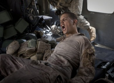 11 June 2011: US Lance Corporal Blas Trevino from 1st Battalion, 5th marines shouts as he is rescued after being shot in the stomach in Afghanistan's Helmand Province.