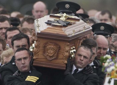The coffin of PSNI officer Ronan Kerr is carried through his home town of Beragh, Co Tyrone, 6 April 2011.