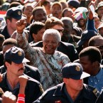 In 1999, he stepped down as president. He is pictured campaigning for his successor, Thabo Mbeki. (AP Photo/ Themba Hadebe)