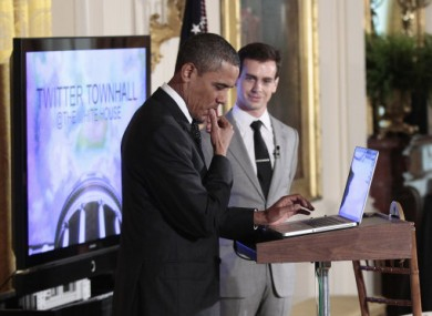 The US President pauses during today's live-tweeting event.