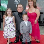 Warwick Davis with wife Samantha and children Annabel and Harrison arriving for the world premiere of Harry Potter And The Deathly Hallows: Part 2 in London.