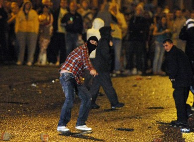 Rioters attack police lines in Belfast on Monday night. Further sectarian disturbances broke out in Portadown last night.