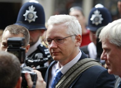 Julian Assange arrives at the High Court in London for his extradition appeal hearing