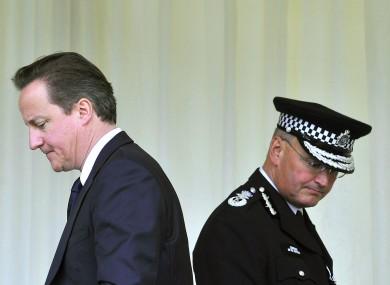 David Cameron and Sir Paul Stephenson who resigned last night (File photo)