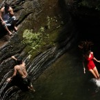 Cooling off at Wissahickon Valley Park, in Philadelphia. (AP Photo/Matt Rourke)