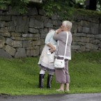 Relatives mourn after today's memorial service in Norderhov, Norway. (AP Photo/Frank Augstein)