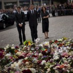 Norway's Prime Minister Jens Stoltenberg, centre, pays tribute to victims of the twin attacks before a memorial service at Oslo Cathedral, Sunday, 24 July, 2011. (AP Photo/Emilio Morenatti)