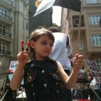 A young girl takes part in anti-government protests in Syria. This image was uploaded to Twitpic by Humanitarian Relief (@IHHen).   Emboldened by their neighbours in Tunisia and Egypt, Syrian people took to the streets looking for reform in March. Since then, their demands have increased and now they want Assad to step down from any position of power.