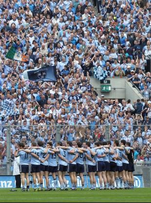 The Dublin senior football team sing the national anthem before kick-off at Croke Park.