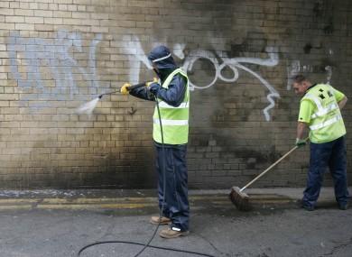 [File photo] Street cleaners remove graffiti in Dublin City Centre