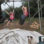 Mary-Ann and Carina play on scaffolding at Dale Farm travellers' site in Essex.