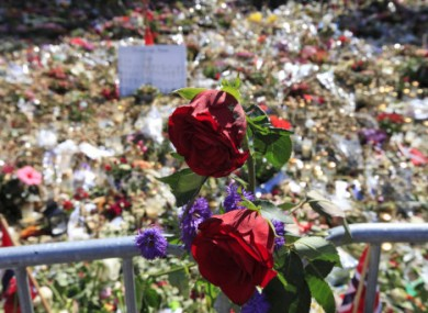Floral tributes to the 77 victims of last month's attacks.