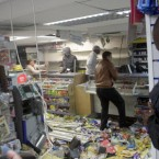 People looting a shop in Hackney last night as the riots rolled on. (Lewis Whyld/PA Wire)
