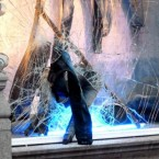 A pair of jeans hangs out of a Diesel shop on King Street in Manchester after trouble in the city centre.