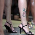 An inmate shows her tattoo while participating in the Miss Penitentiary beauty contest at the Women's Prison of Brasilia, Brazil, yesterday. (AP Photo/Eraldo Peres)