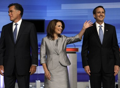 Michelle Bachmann (centre) and Tim Pawlenty (right) have both been keen to catch up on the Republican frontrunner, Mitt Romney (left).