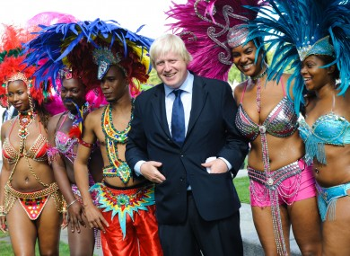 London Mayor Boris Johnson pictured with members of the Genesis Mas band, who will be performing at the Notting Hill Carnival this weekend