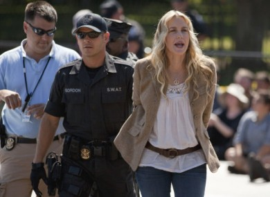 Daryl Hannah being led away in handcuffs from today's protest outside the White House.