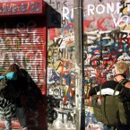 Italian backpackers add their messages to the wall of graffiti dedicated to U2 at Windmill Lane [File photo: Photocall Ireland]
