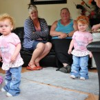 Twins Evelyn and Megan during a visit by the Bishops of Chelmsford and Brentwood to a caravan at Dale Farm.