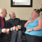 The Anglican Bishop of Chelmsford Stephen Cottrell and Catholic Bishop of Brentwood, Thomas McMahon visit Nora Sheridan in her caravan at Dale Farm travellers' site in Essex.