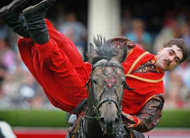 A member of the Ukranian Cossack group perform horsemanship tricks in the main arena at the RDS Dublin, during the opening day of the RDS Dublin horse show