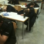 Police officers sleep at their desks between duties during the UK riots (PCStanleyWMP on Twitpic)