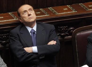 Berlusconi enjoys a parliamentary debate